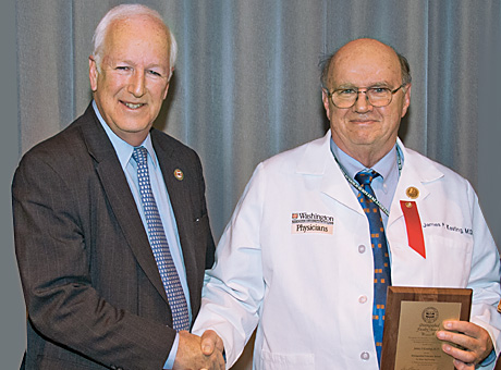 Dean Larry J. Shapiro, MD, left, congratulates James P. Keating, MD.