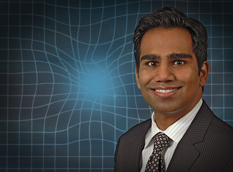 Rajesh C. Rao, MD, with a simulation of macular degeneration