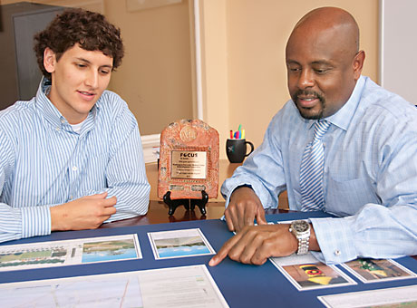 Matthew Green, community development intern, left, and Brian K. Phillips, execut