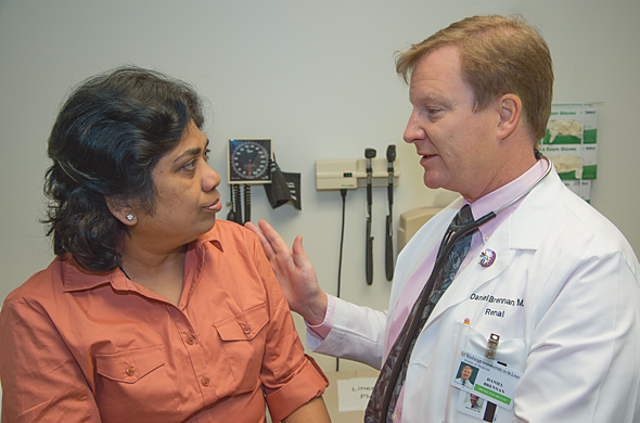 Daniel Brennan, MD, with patient.