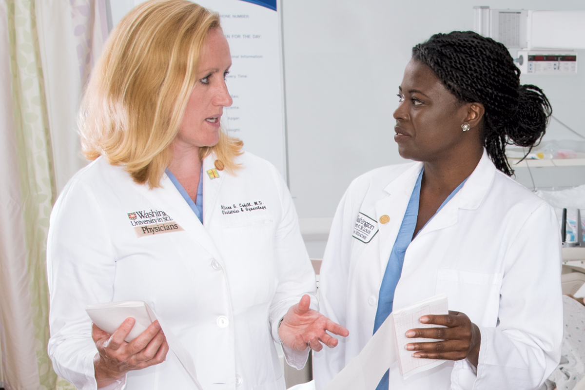 Research opportunities extend from the bench to the bedside. Above, Alison G. Cahill, MD, MSCI (left), associate professor of obstetrics and gynecology, confers with medical student Fayola Fears about a research project focused on infant neurodevelopment.