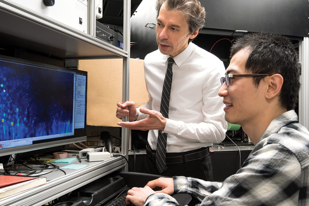 Over the past decade, Azad Bonni, MD, PhD, has contributed insights on how the brain is hardwired, and how neurons take shape and connect to each other. He also is determining how mutations in proteins implicated in autism cause problems. Here, Bonni (standing) confers with staff scientist Yue Yang, PhD.