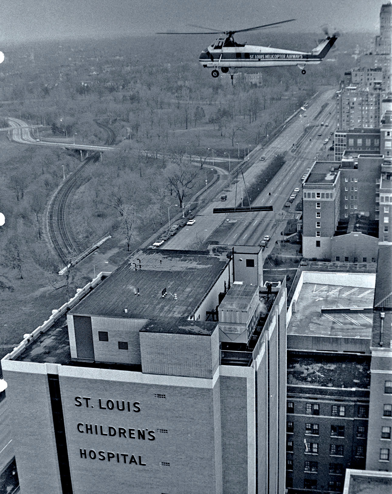 A helicopter heading to St. Louis Children's Hospital, c. 1970.