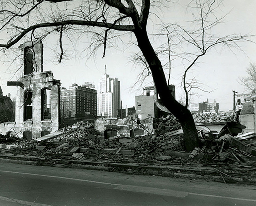 Dilapidated buildings with Grant Avenue skyline in background, 1961.