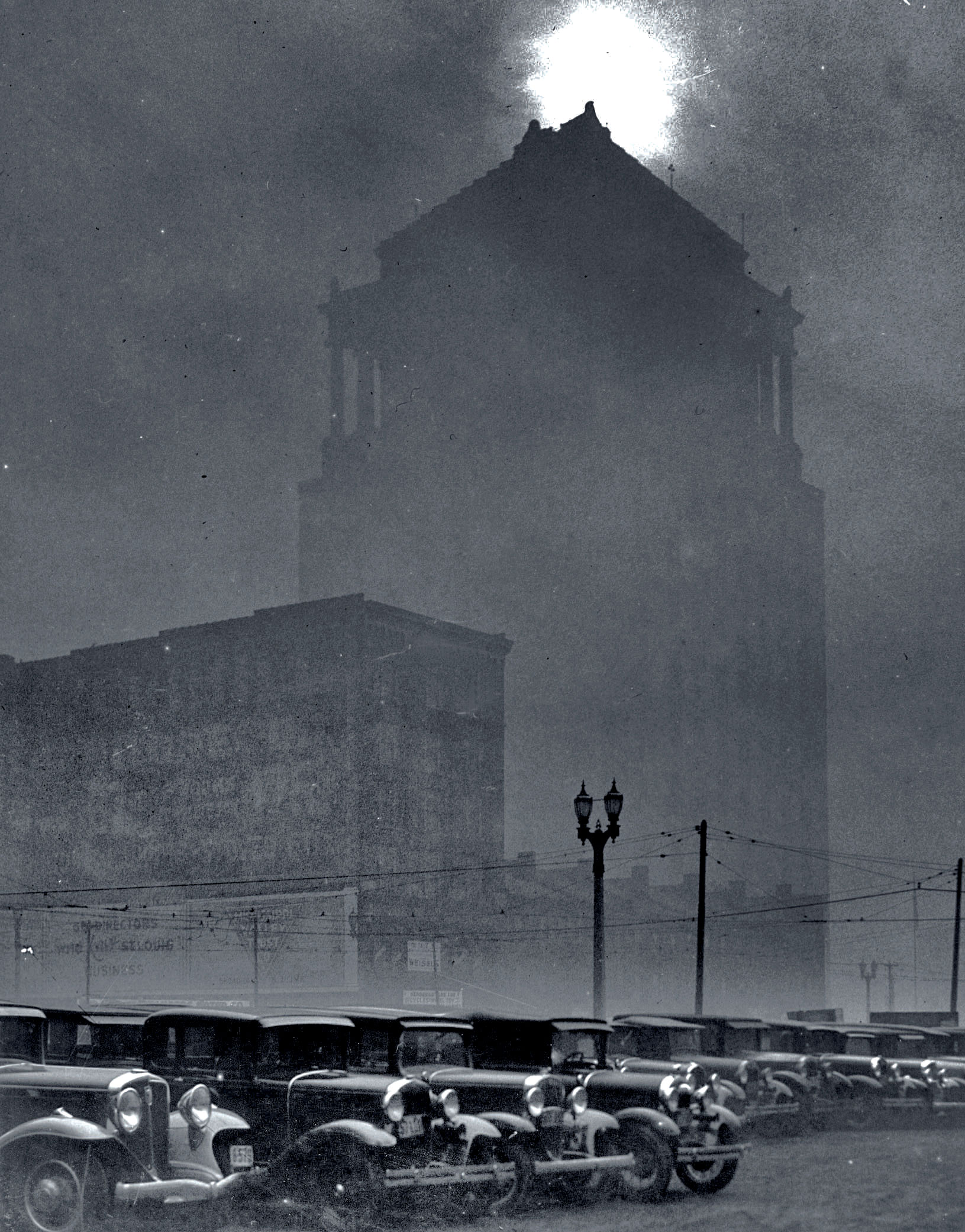 Views of the Civil Courts Building as smoke pollution blots out the sun at midday in 1939.