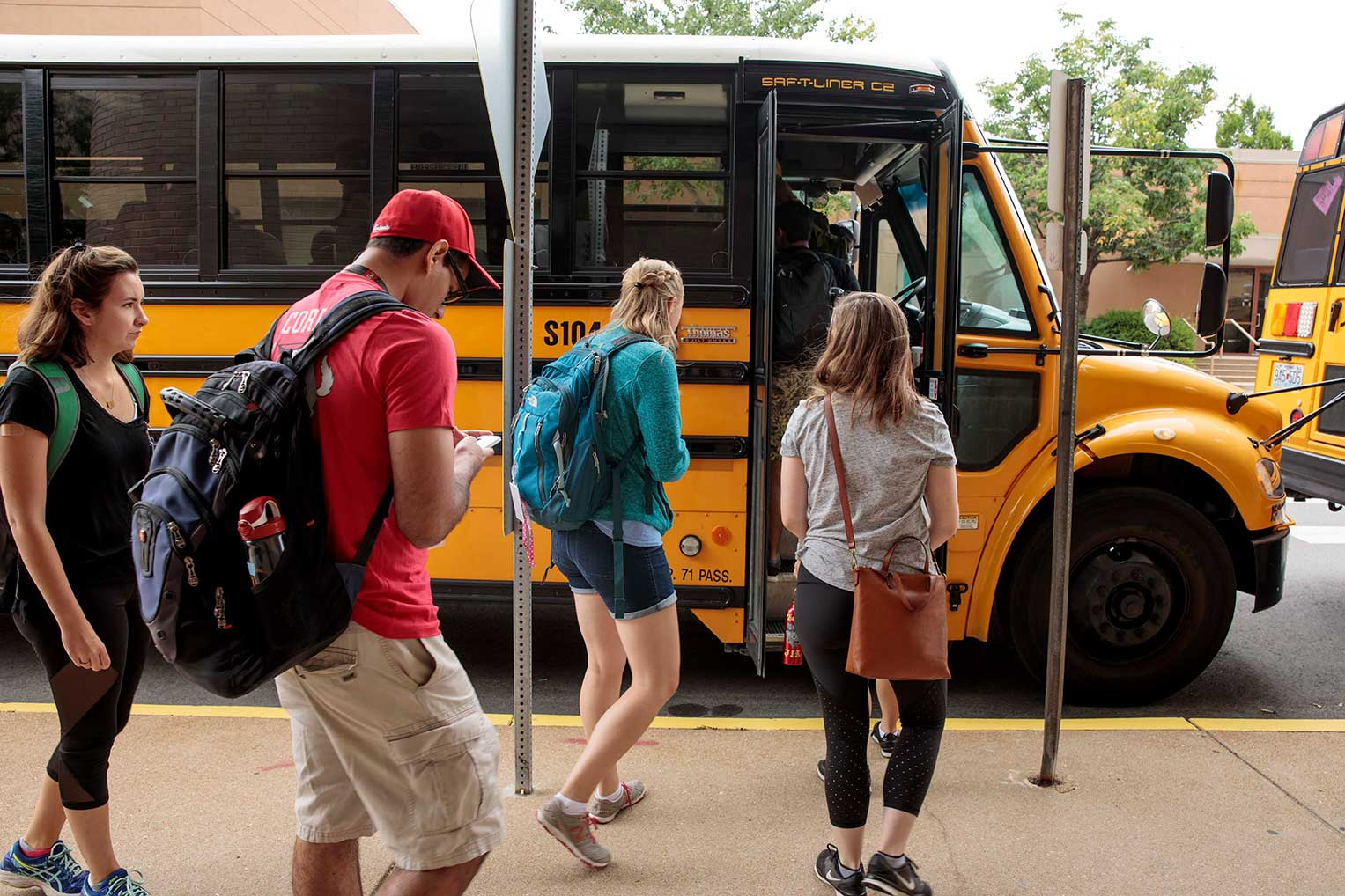 Students begin a bus tour of underserved communities.