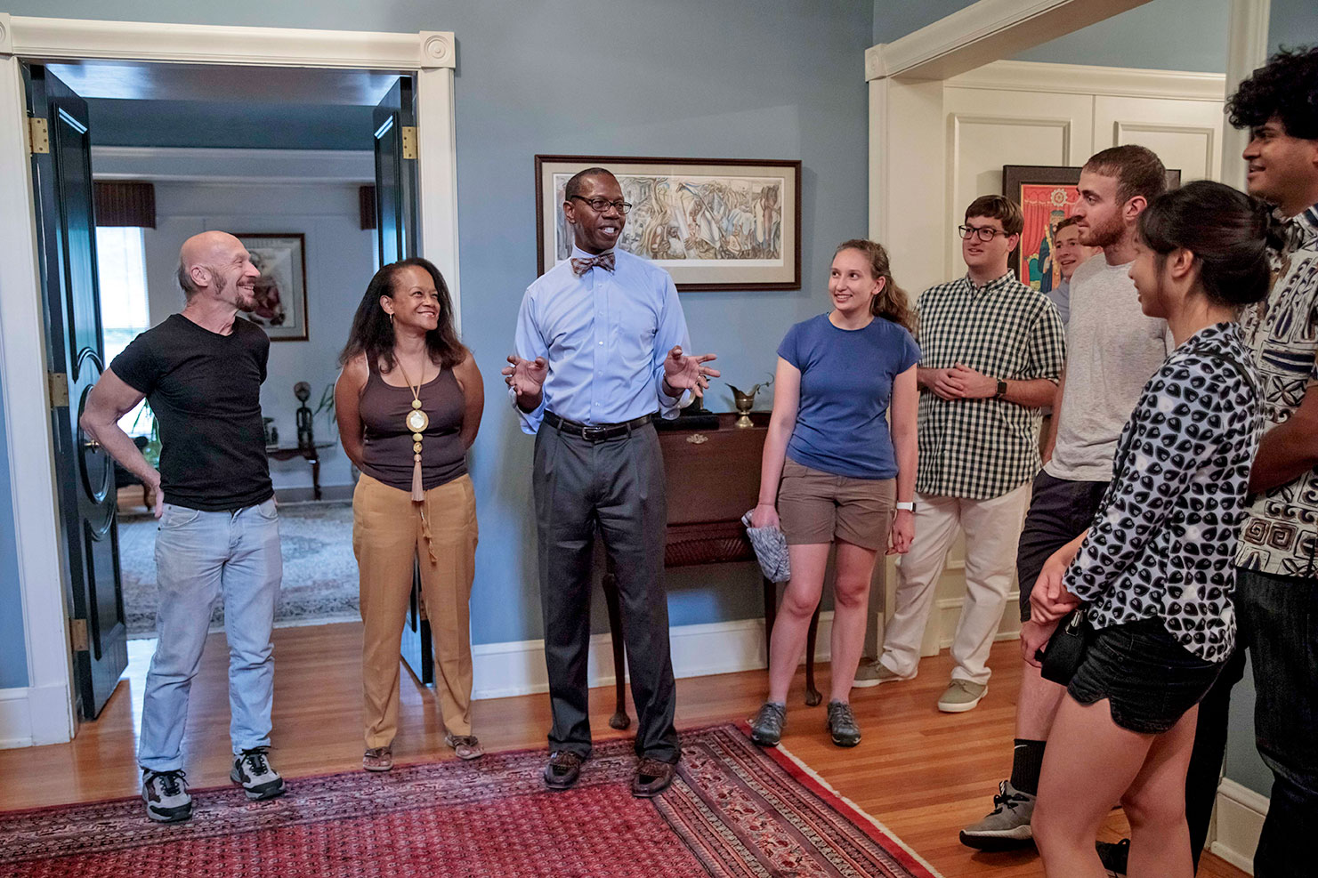 During the orientation program, Ross and his wife, Arlene, second from left, host students in their Central West End home.