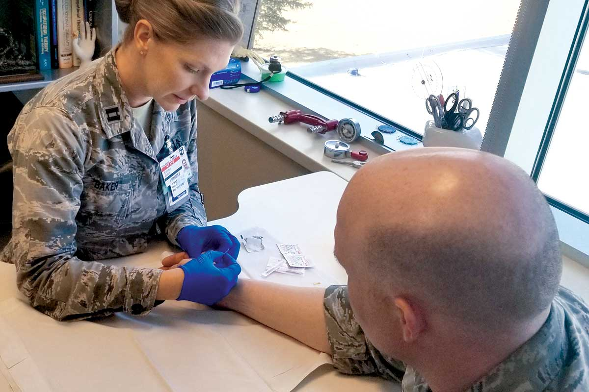 Stimulating trigger points to reduce pain at the Air Force Academy clinic in Colorado Springs.
